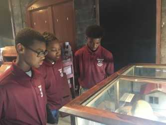 Students look in museum box