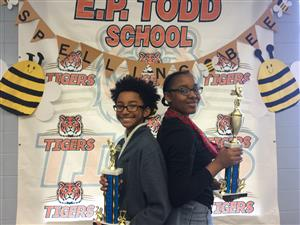 spelling bee winners with trophy