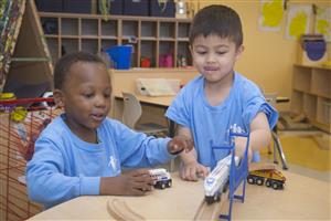 students playing with trains together