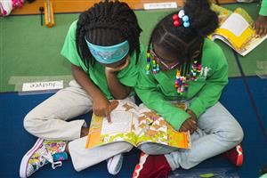 first graders partner reading